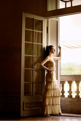 Model wearing a long beige dress