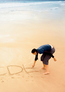 Woman writing in sand