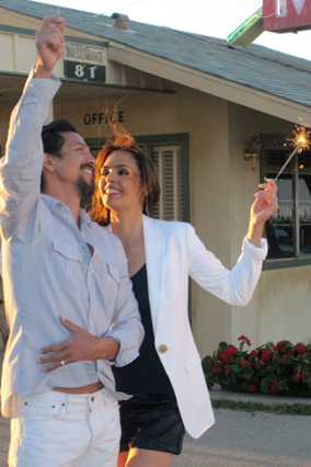 Benjamin Bratt and Talisa Soto with sparklers in O, the Oprah Magazine