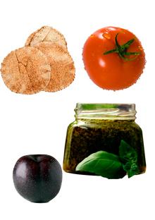 Pita, tomato, pesto, and plum