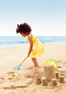 Girl making sand castle