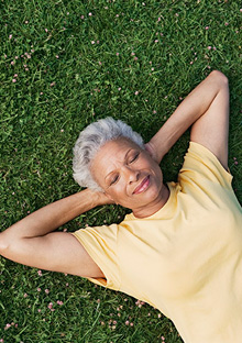Woman resting on grass