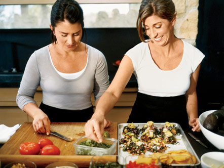 Jewels and Jill Elmore cooking in Jennifer Aniston's kitchen