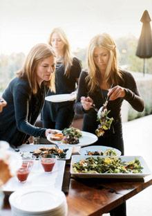 Jennifer Aniston serving food at her home