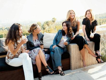Mandy Ingber, Jennifer Meyer, Courteney Cox, Jennifer Aniston, and Kristin Hahn talking on a veranda