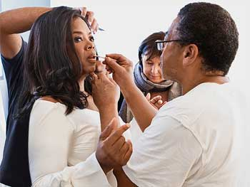 Oprah Winfrey getting makeup done