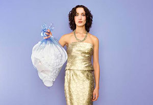 woman holding trash bag
