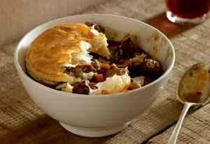 Puff pastry disk on top of steak and kidney pie