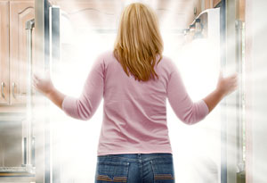 woman in front of refrigerator