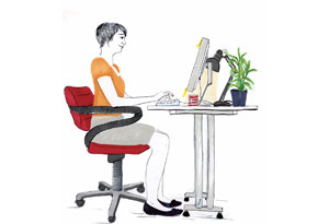 Woman seated at workstation