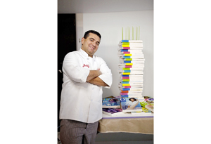 Buddy Valastro with O's 10th anniversary cake