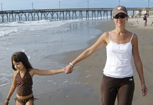 Bremer and her daughter walking on the beach