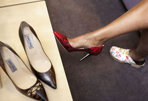 Gayle King trying on shoes