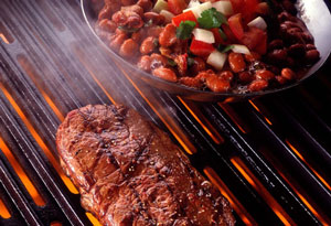 Steak and beans on a grill