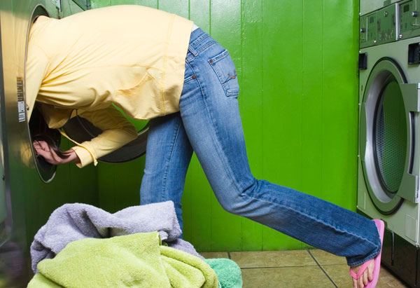 Woman reaching into dryer