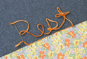 Yarn spelling out the word rest