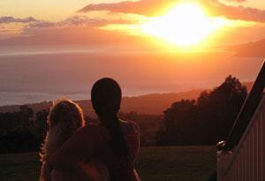 Oprah and Sadie watching the sun set