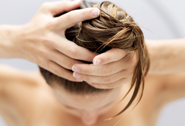 Woman with wet hair in the shower