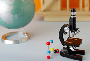 microscope with globe and toys