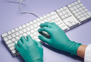 Gloved doctor hands typing