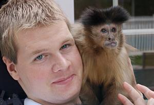 Ned Sullivan and his monkey helper Kasey