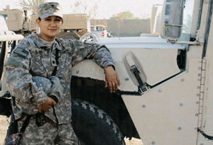 Victoria Olmo with a humvee in Camp Victory