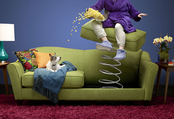 Woman being ejected from sofa