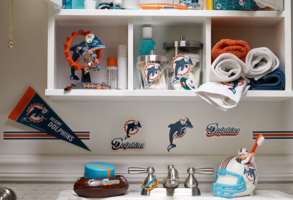 bathroom decorated with sports memorabilia