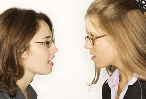 Two women in glasses arguing