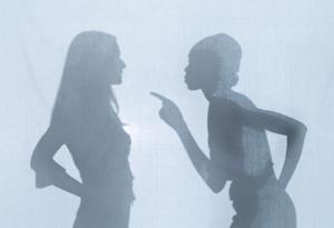 Silhouette of women having an argument