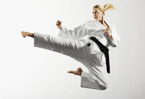 Woman jumping and kicking