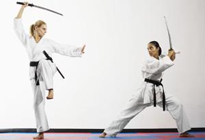 Two women facing off with samurai swords