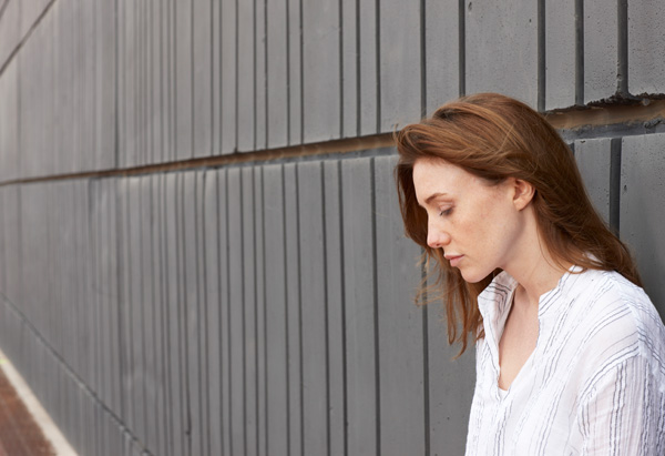 Woman standing by a wall