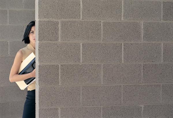 Woman behind wall