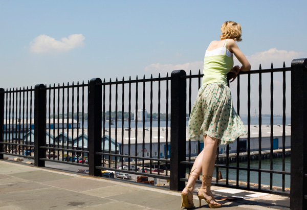 Woman looking over fence