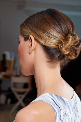 Woman with sleek chignon