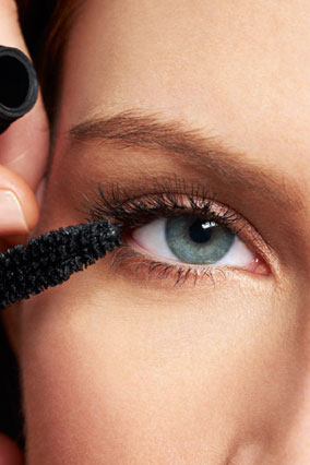 Mascara wand on lashes
