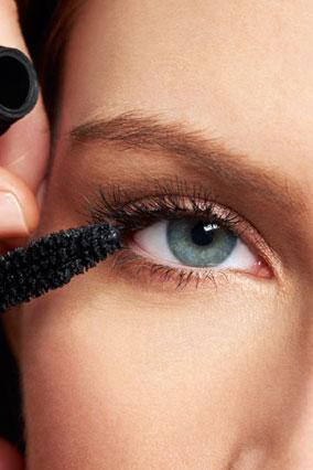 Mascara wand on lashes