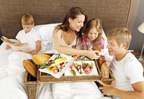 Family breakfast in bed