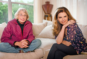 Mary Oliver and Maria Shriver sitting on couch