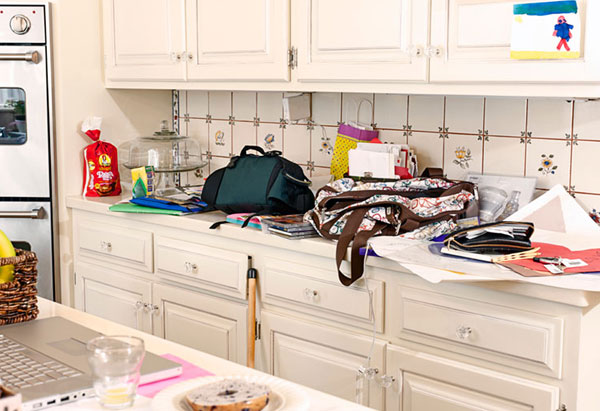 Messy, cluttered kitchen counter