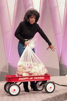 Oprah with a wagon loaded with 67 pounds of fat