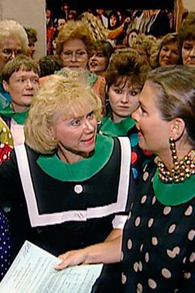 audience members wearing fabric collars