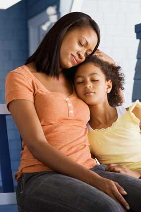 Woman reassuring child