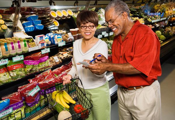 senior couple grocery shopping