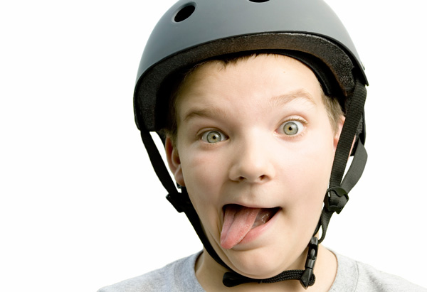 Kid in helmet making funny face