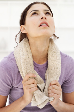 Woman after workout with towel around neck