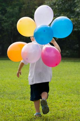 boy run balloons
