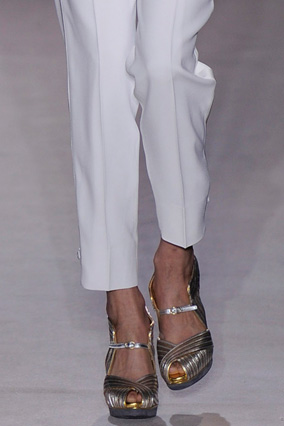 White clothes with metallic accessories