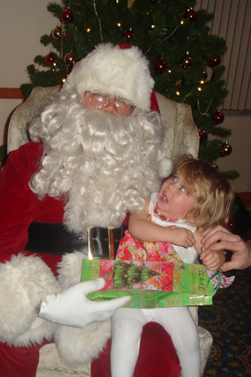 Screaming child on Santa's lap